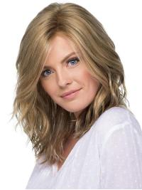 Falling below the shoulders, this wig has free-flowing, gentle waves which create the perfect touch of natural movement.