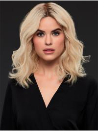 This wig is a gorgeous long bob shines with the natural finesse of human hair, enhanced by a nearly invisible SmartLace front and a hand-tied, light-density cap for airy movement.