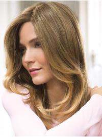 It is a lovely, long smooth hair below-the-shoulder look, with extra long layers sculptured to frame the face.