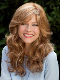 It is a glamorous look with lush, softly, wavy layers cascading from a smooth crown and long sweeping fringe.