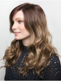 It is a sultry look with luscious long wavy layers that fall well below the shoulders.