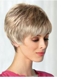 It is a short pixie-like layered cut with face framing fringe bangs.
