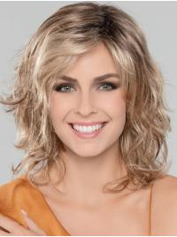 A curled, textured bob with an extended lace front.