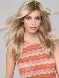 Elegant, tumbling tresses with a part monofilament and an extended lace front.