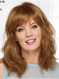Lush layers of soft, beachy waves gently pour past the shoulders to the upper back in this this breezy long wig.