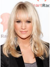 The wig's medium, wavy, romantic, blonde hairstyle with bangs looks feminine and edgy.