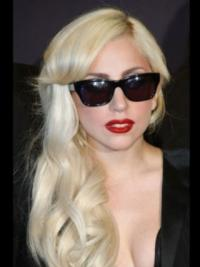 Leaving her signature extravaganza to the side, Lady Gaga hit the town promoting her new album 'The Fame Monster' wearing her platinum blonde hair styled with loose waves and peek-a-boo bangs.