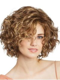 A modern, punchy bob with loose ringlets all over that will make your look sizzle this summer!
