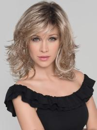 This wig is the perfect mid-length shag with wispy layers and just the right balance all over.