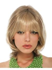 This wig is a shoulder length, layered style with soft bangs that frames the face.